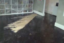 Dark floor partially sanded
